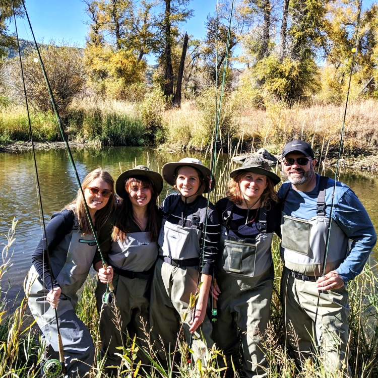 Husband, Wife, and 3 grown daughters in fly-fishing garb by lake