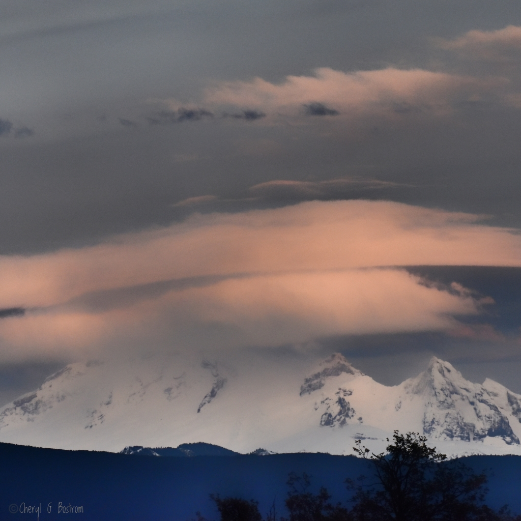 Two-lenticular-clouds-over-mountain
