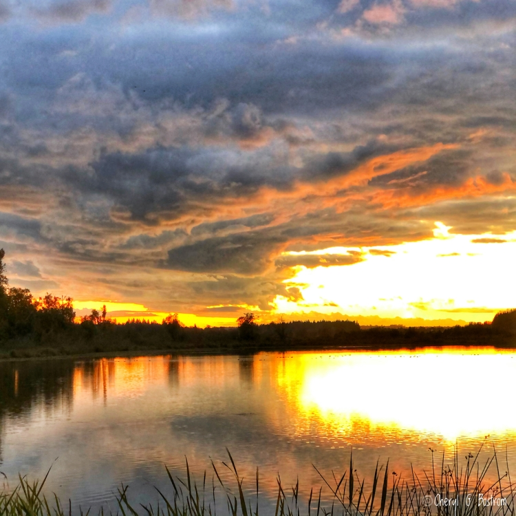 Brilliant reflection in Wiser Lake from clouds and sunset