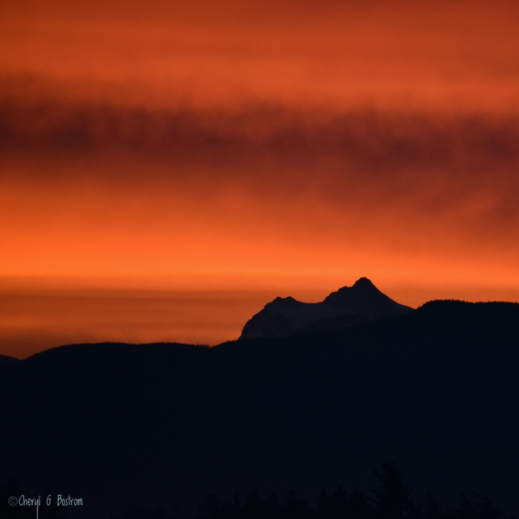 Red morning sky over silhouetted Mt.Shuksan