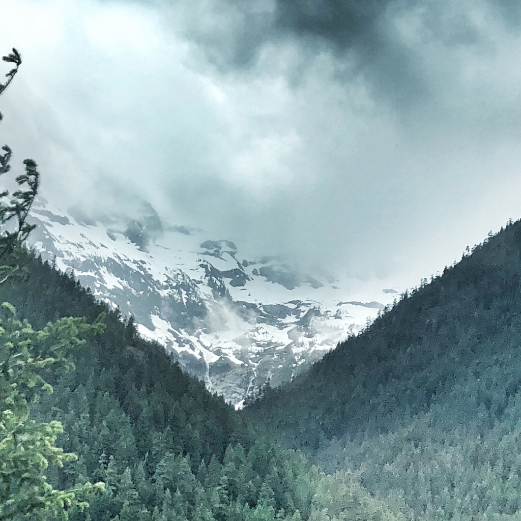 Peaceful-snowy-mountain-through-forested-slot