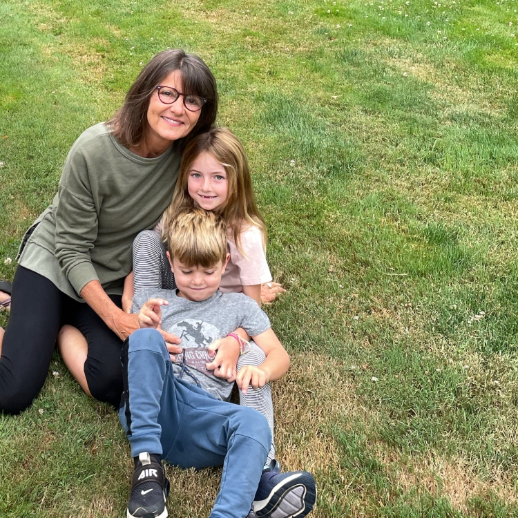 grandmother-with-two-grandkids-on-lawn