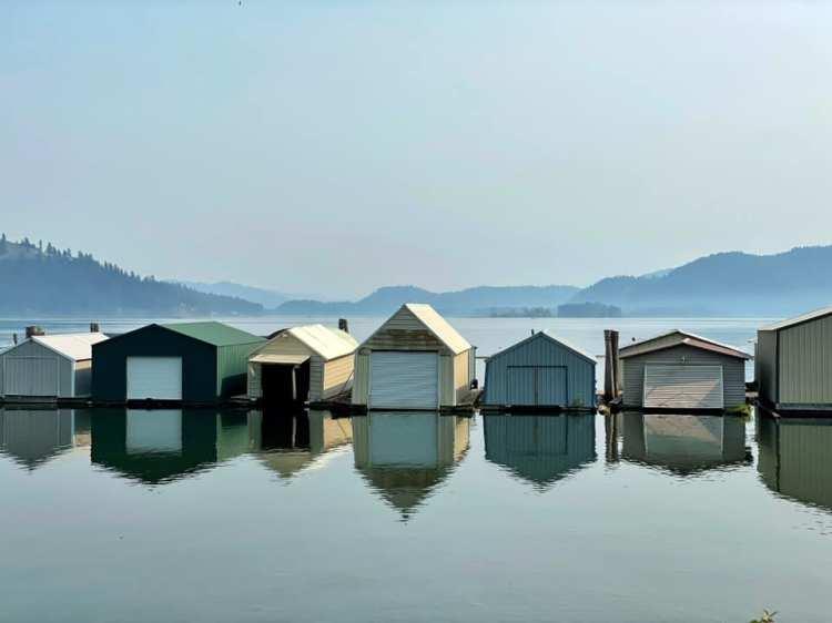 houseboats-reflected-glassy-lake-coeur-d-alene